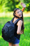 Attractive woman glasses rucksack Royalty Free Stock Photography