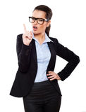 Attractive woman with glasses showing by finger Stock Image