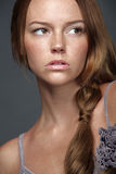 Attractive woman with gold blond curly hair. Stock Photo