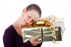 Attractive woman with golden package Royalty Free Stock Photography