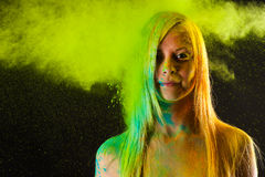 Attractive woman in green colors Holi Stock Photography