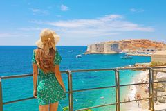 Attractive woman with green dress enjoys the view of the old town of Dubrovnik, Croatia stock image