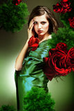 Attractive woman in green fabric Stock Photos
