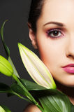 Attractive woman with green flower Stock Images