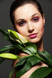 Attractive woman with green leafs Stock Photo