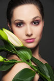 Attractive woman with green leafs Stock Image