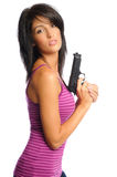 Attractive woman with a gun. Attractive hispanic woman holding a gun on a white background Royalty Free Stock Photo