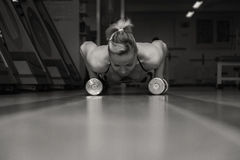 Attractive woman in gym royalty free stock photography