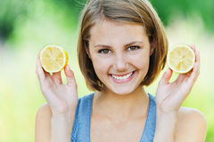 Attractive woman half lemon Royalty Free Stock Photos