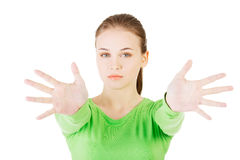 Attractive  woman with hands open in front oh her. Royalty Free Stock Photos
