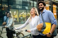 Happy young couple spending time together with dog and bicycles. Attractive women and handsome men spending time together with dog and bicycles royalty free stock photos