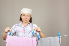 Attractive Woman Hanging Wet Clean Cloth To Dry On Clothes Line Stock Photos