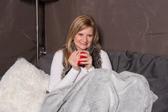Attractive woman has a warming drink in her hand Stock Photo