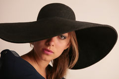 Attractive woman in hat Stock Photos