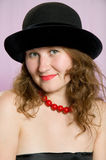 Attractive woman in hat Stock Images