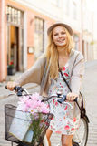 Attractive woman in hat with bicycle in the city Stock Photo