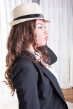 Attractive woman with hat in business outfit Stock Image