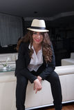 Attractive woman with hat in business outfit Royalty Free Stock Photo