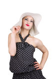 Attractive woman in hat and dotted dress Royalty Free Stock Photography