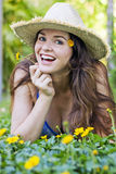 Attractive woman in hat and flowers Stock Photos