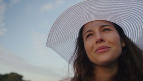 Attractive woman in a hat looking out stock video footage