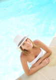Attractive woman with hat in a pool Stock Photography