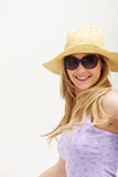 Attractive woman with hat and sunglasses Stock Photo