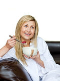 Attractive woman having a breakfast. Against a white background Stock Photo