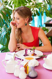 Attractive woman having breakfast in cafe Stock Photography