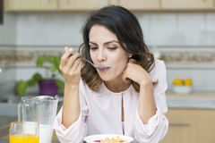 Attractive woman having breakfast Royalty Free Stock Images