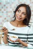 Attractive woman having breakfast in kitchen royalty free stock images