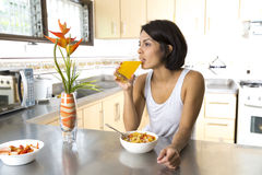 Attractive woman having breakfast Stock Photos