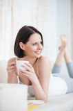 Attractive woman having coffee at home Royalty Free Stock Photo