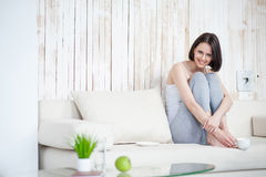 Attractive woman having coffee at home Stock Photo