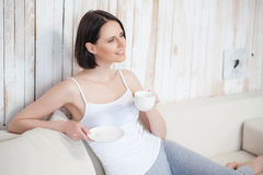 Attractive woman having coffee at home Stock Images