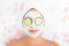 Attractive woman having cucumber on her face Stock Photography