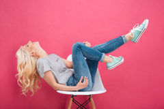 Attractive woman having fun on the chair Royalty Free Stock Photos