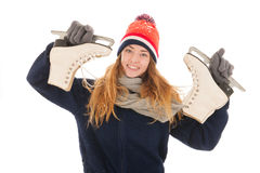 Attractive woman is having fun with ice skates Royalty Free Stock Photography