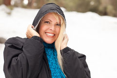 Attractive Woman Having Fun in the Snow Royalty Free Stock Photos