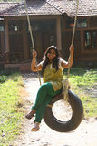 Attractive Woman having fun on tire swing Royalty Free Stock Photos