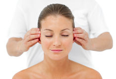 Attractive woman having a head massage Stock Photos