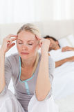 Attractive woman having a headache Royalty Free Stock Image