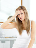 Attractive woman having a headache in the bathroom Royalty Free Stock Photos