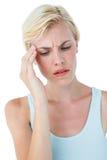 Attractive woman having headache Royalty Free Stock Photos