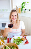 Attractive woman having an healthy dinner Royalty Free Stock Photos