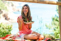 Attractive woman having healthy picnic outdoors. Stock Images
