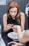 Attractive woman having a manicure at the salon Stock Images