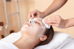 Attractive woman having mask in spa salon Royalty Free Stock Image