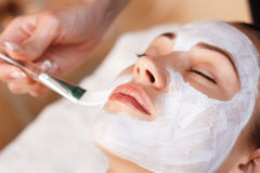 Attractive woman having mask in spa salon Stock Images