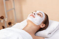 Attractive woman having mask in spa salon Stock Photography